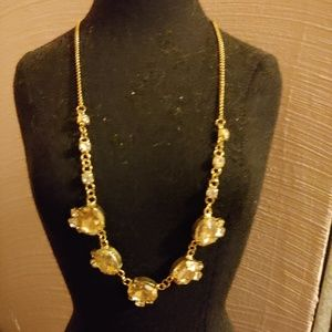 Gold necklace and earring set.